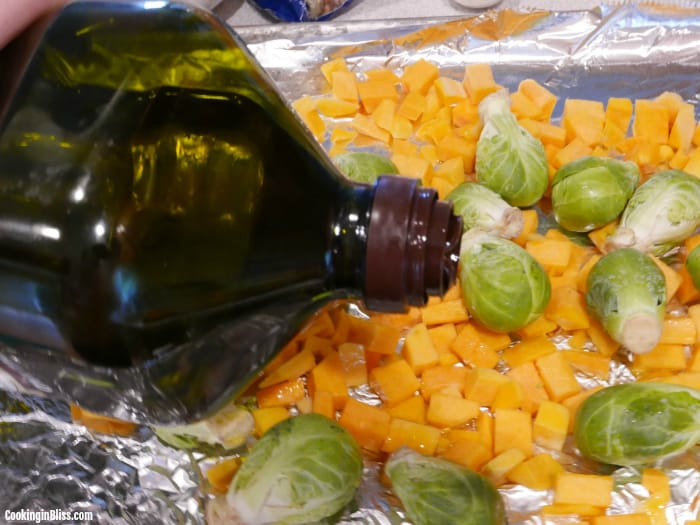 drizzle brussels sprouts and butternut squash with olive oil