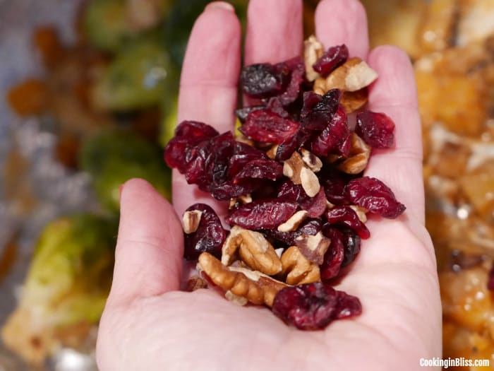 Garnish with pecans and dried cranberries