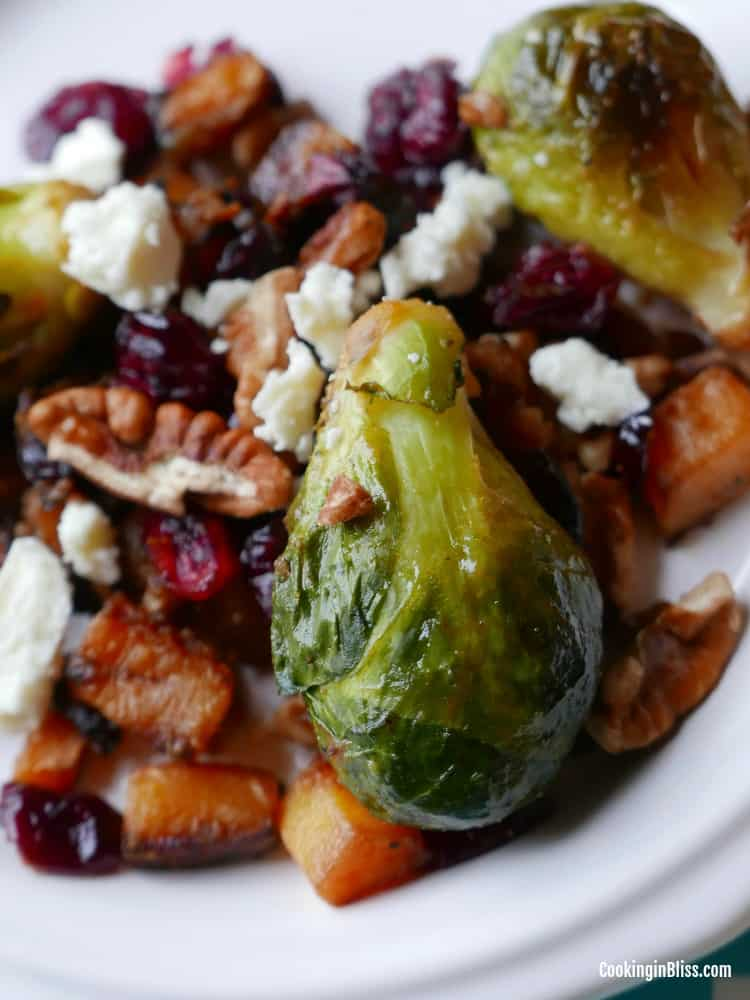 Quick and easy roasted brussels sprouts and butternut squash with pecans and dried cranberries recipe